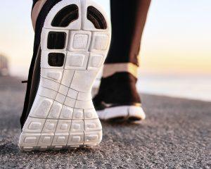 closeup-sport-shoes-concrete-path